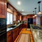Arts-&-Crafts-Kitchen-with-tropical-green-granite