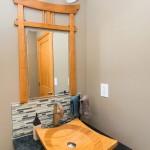 Asian-archway-mirror-frame-and-stone-backsplash
