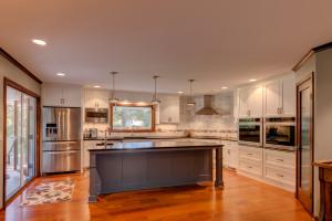 Modern White Kitchen with Gray Island